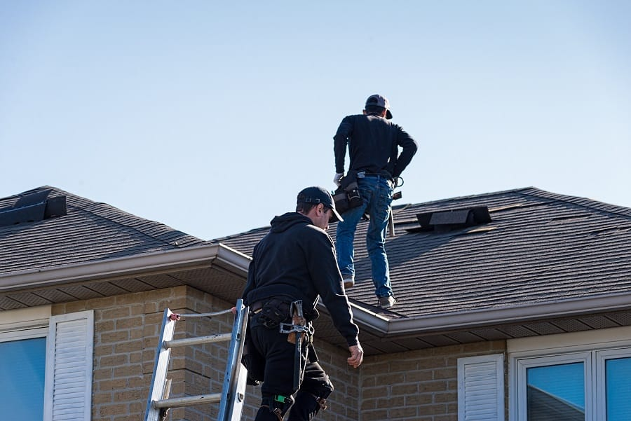 roofers inspecting roof